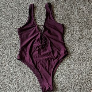 Sexy high hip, lace up one-piece